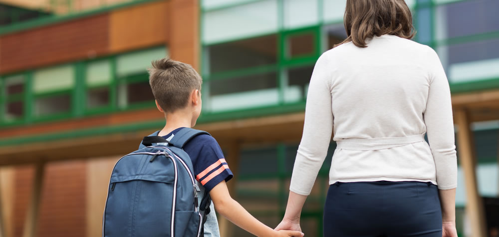 Mom walking with kid at school