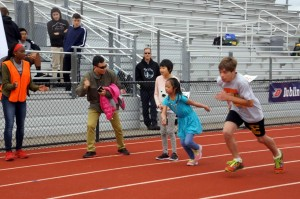 special olympics kids running on the track, race start