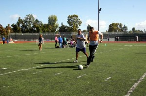 Two special olympics kids on soccer field