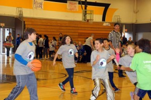 Special olympics kids playing basketball