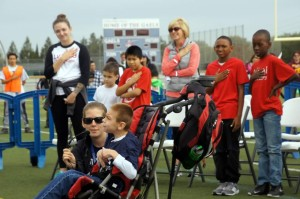 Special olympics kid singing national anthem