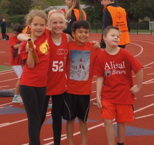 special olympics kids running on the track