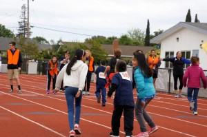 special olympics kids racing, seen from behind